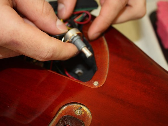 Remove the potentiometer from the instrument by gently pulling it upward.
