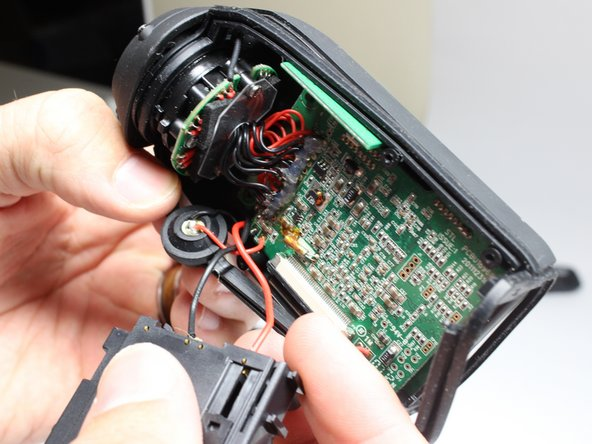 Remove the microphone first from the rubber housing it is located in, after which you will disconnect the wires connecting the microphone to the motherboard from where they are attached on the motherboard. You will then solder the new speakers wires in the same locations on the motherboard as the wires you just removed.
