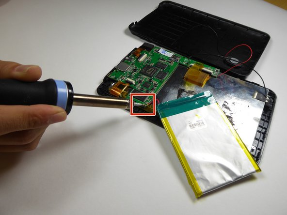 Image 1/3: Use a soldering iron to detach the battery wires from the motherboard.