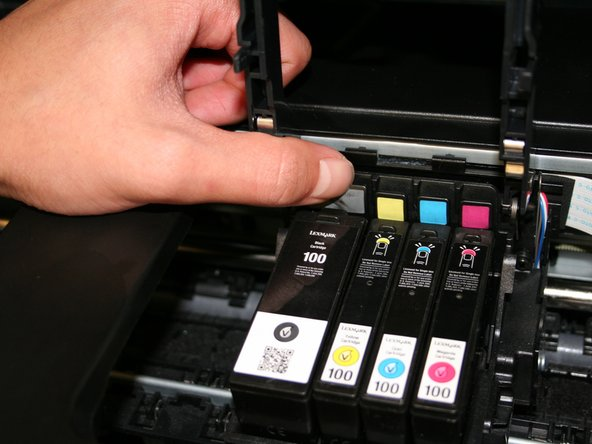 Push the button located above the designated ink cartridge until it pops out.