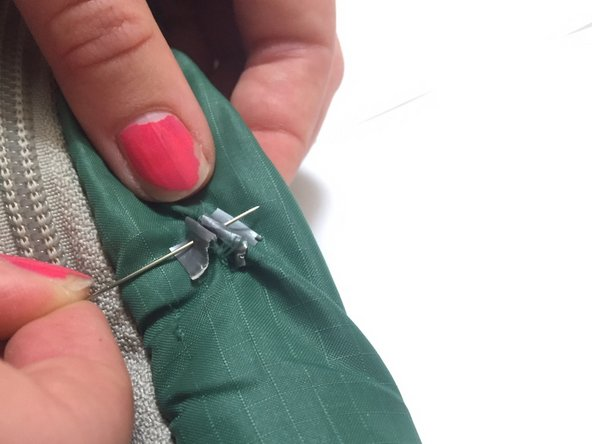 Push the two pieces of duct tape together and use the needle and thread to sew them together with a whip stitch.