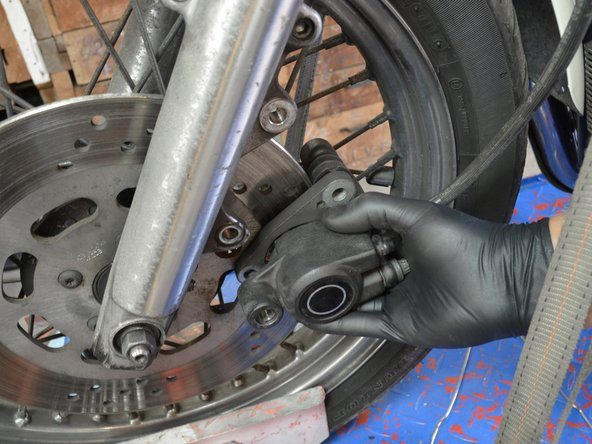 Slide the brake assembly until the lower hole in the brake assembly aligns with the lower mount hole on the fork.