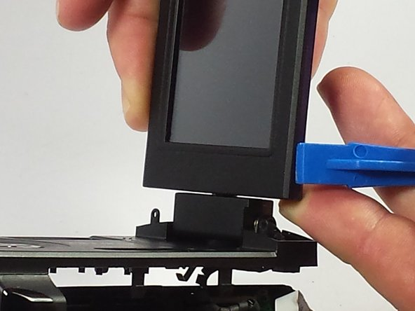 Use the plastic opening tool to pry the outer part of the screen, now attach the new one.