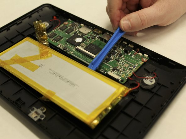 The battery is glued down, so some force may be required to remove it from the back cover.
