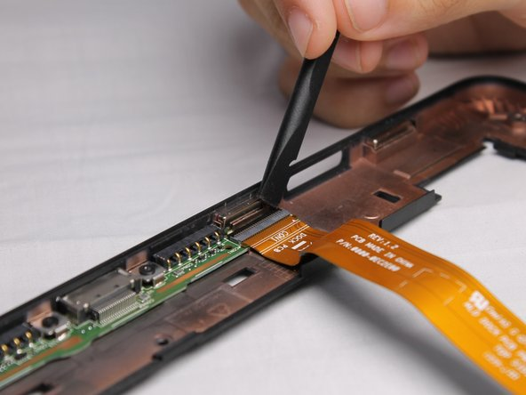 To remove the second ribbon cable you must first raise a black retainer with a thin plastic tool.  Then you must pull the cable down to free it from the frame.