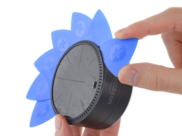 Using opening picks to open the Echo Dot during the teardown