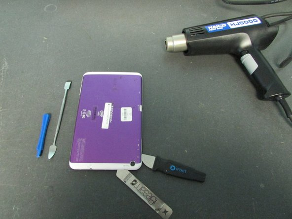 Use a Heat Gun to heat the sides of the device one at a time.  The Heat Gun will loosen the adhesive.