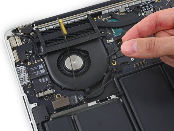 Carefully peel the right speaker cable off the upper case.