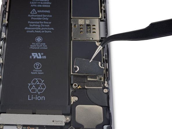 Remove the battery connector bracket from the iPhone.