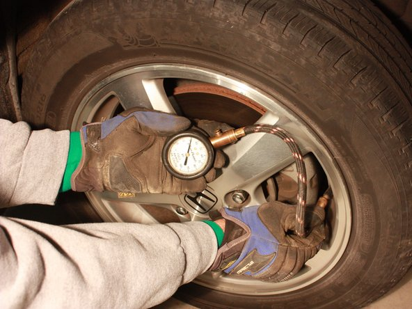 Using an air compressor and the air pressure gauge, fill the front and rear tires to appropriate amount.