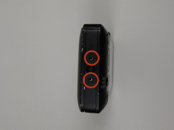 Image 2/2: There are (2) screws located on the left side of the camera. These screw locations are depicted with the red circle markings in the second photo of this step. These screws are 2 mm long.