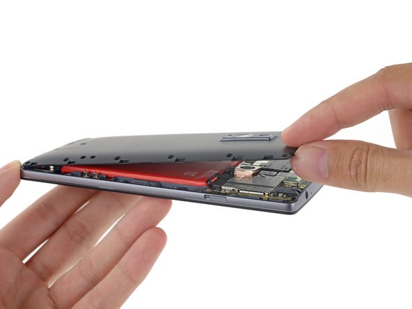 Image 1/2: A peek inside reveals the signature red battery and a bit of the motherboard.