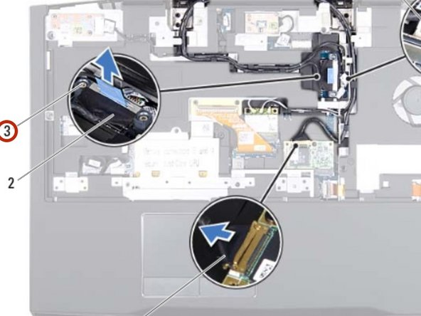Tighten the two captive screws that secure the display cable to the system  board.