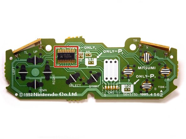 The chip on the board is a 12-bit shift register, used to multiplex all the button signals on the controller into a more budget-friendly connector.