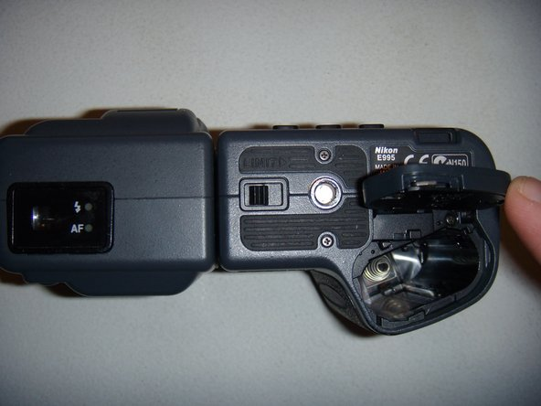 Lift the battery compartment cover and remove the old battery.