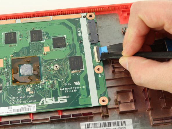 Using the black nylon spudger, unlock the black bar on the ZIF connector attached to the mid-right of the motherboard.