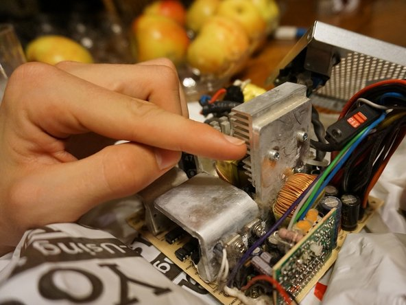 To remove the heat sink simply detach the two back screws with a medium sized screwdriver