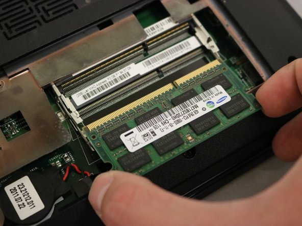 Pull the RAM out from the slot.
