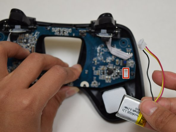 Use fingers to gently detach the battery wires from the motherboard.