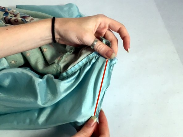 Stitch from that point to the seam line on the lining, forming a slight curve.