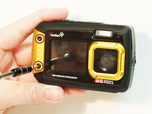 With the H2.0 bit screwdriver, remove the two screws on the yellow waterproof cover