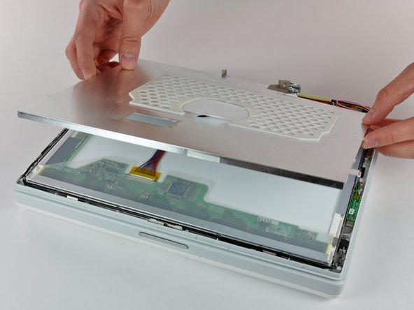 Carefully remove the thin steel LCD cover.