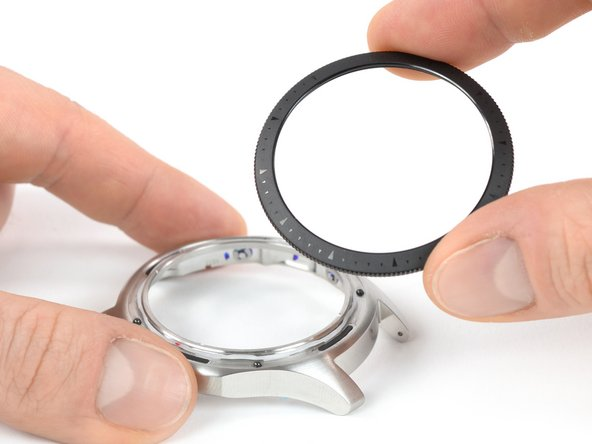 What comes to light is a separate plastic ring and four metal ball bearings.
