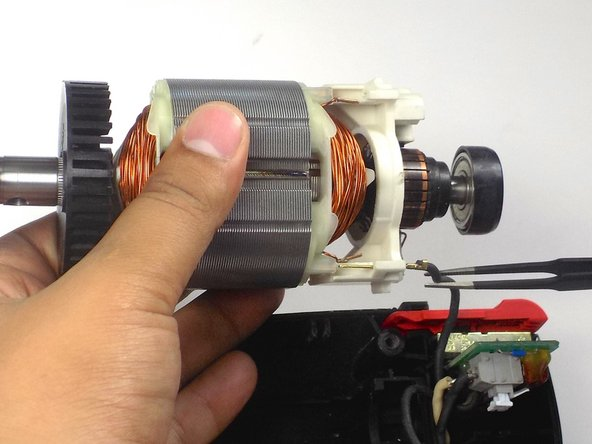 Rotate the motor away from you so that the second wire is visible, and detach that wire as well.