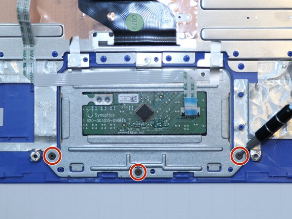 Use a Phillips #00 screwdriver to unscrew three 2.25 millimeter screws from the trackpad.