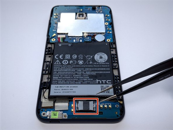 Using Tweezers, remove loud speaker that is being held by small adhesive.