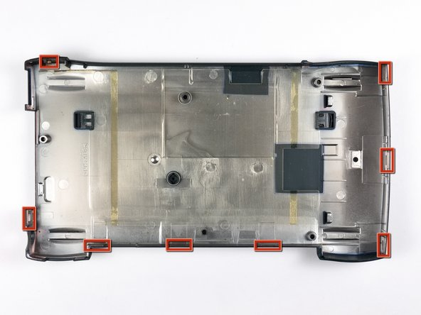 In the next step you will remove the rear case which is attached to the Newton by several clips around its perimeter. The location of the clips is shown in the second picture.