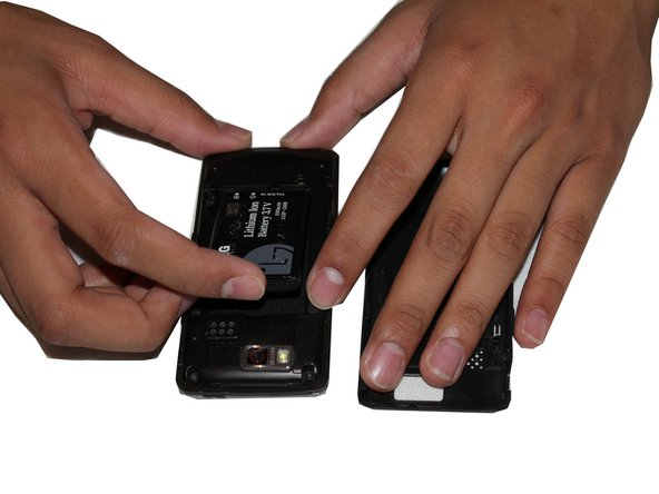 Simply insert your finger in between the slot and the battery and push down and up to remove the battery.