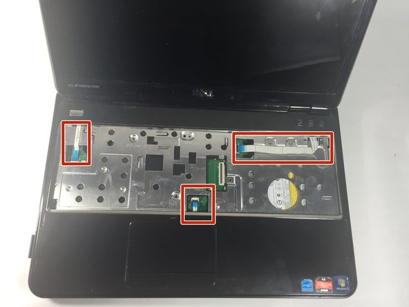Disconnect the power button board cable, touch pad cable and the hot key board cable from the connectors.