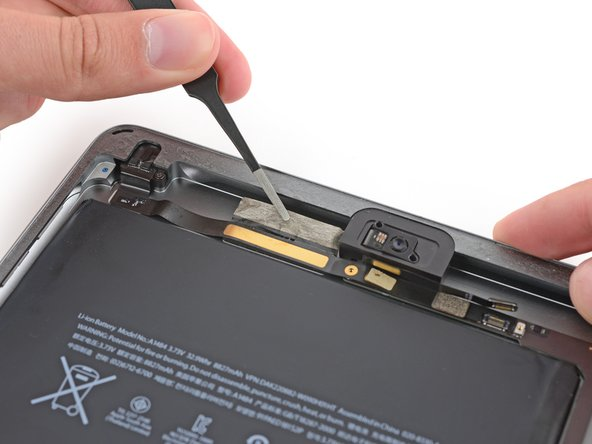 Lift the tape covering the headphone jack cable toward the top of the iPad to free the cable for removal.