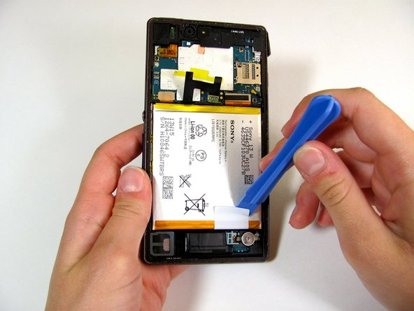 Use your fingers to peel back the rest of the adhesive tape away from the battery.