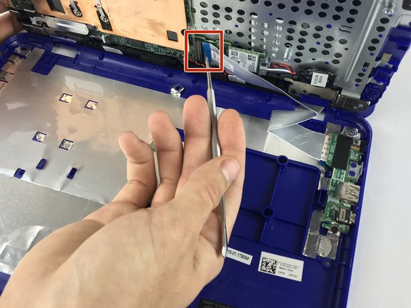 While separating the halves of the bottom cover, carefully move the spudger up and down to avoid damaging the USB/Audio circuit board cable inside.
