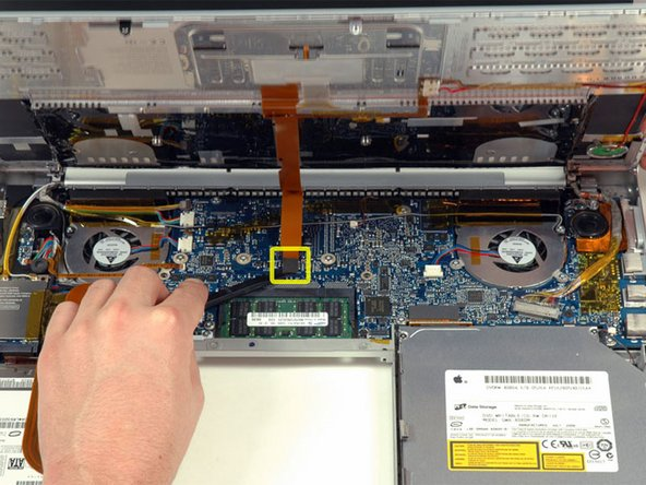 Use a spudger to re-seat the trackpad/keyboard ribbon cable connector to its socket on the logic board.