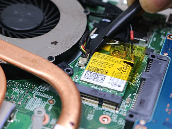 Unplug both of the fan power cords from the laptop using a spudger.
