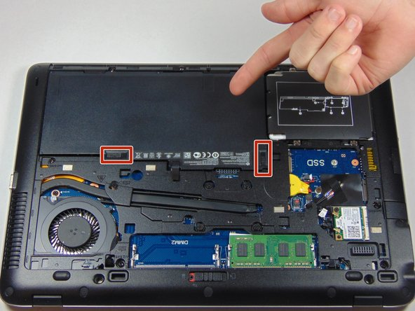 Once the cover is removed you will be able to see the battery and the two latches that hold it in place.