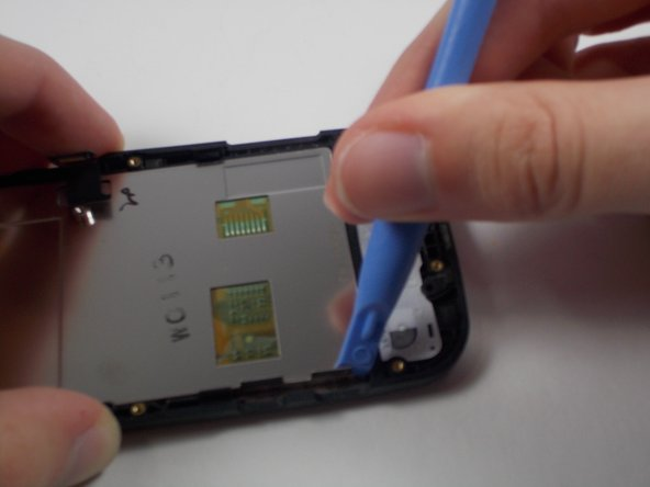 Use the prying tool to unattach the screen to the plastic casing of the phone, If that doesn't work, the next step has an alternative method.