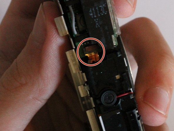 Remove the circuit ribbon connecting the flash to the camera in order to proceed to the next instruction.