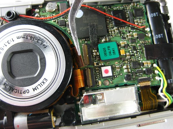 There are two additional film strips connected to the circuit board that do not need to be removed. These are connected to the side of the circuit board that is opposite to the lens