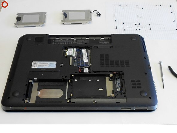 Image 2/2: Remove the empty hard drive bracket and hard drive. Set them aside until re-assembly.