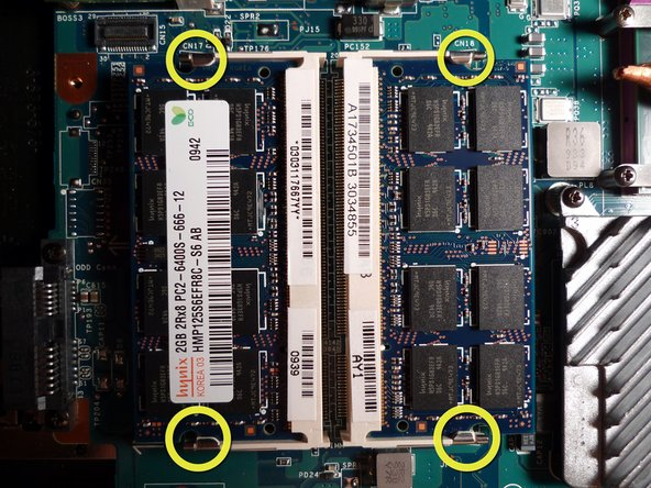 - If you are replacing your RAM, simply unpop the four latches and slide out the memory sticks.