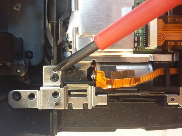 Remove two screws holding plastic/metal frame.