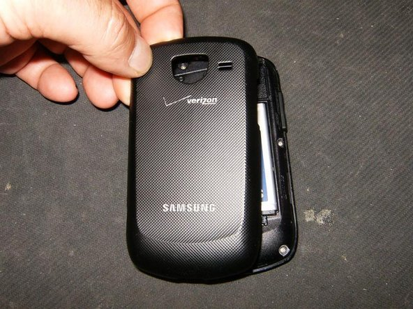 Image 3/3: Remove the backcover by simply pulling it off the phone from the top down