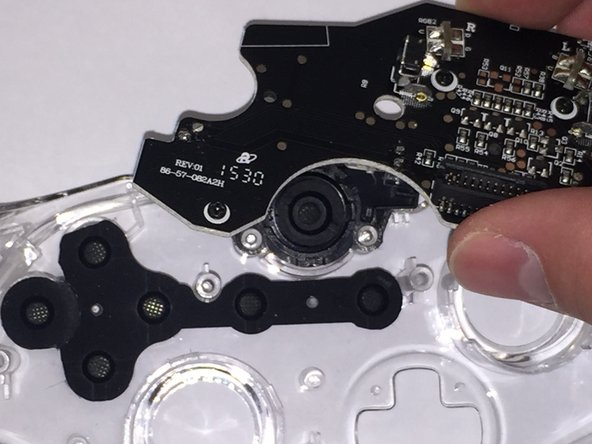 Lift the circuit board off of the controller.