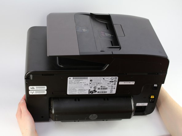 Turn the printer so the back is facing you.