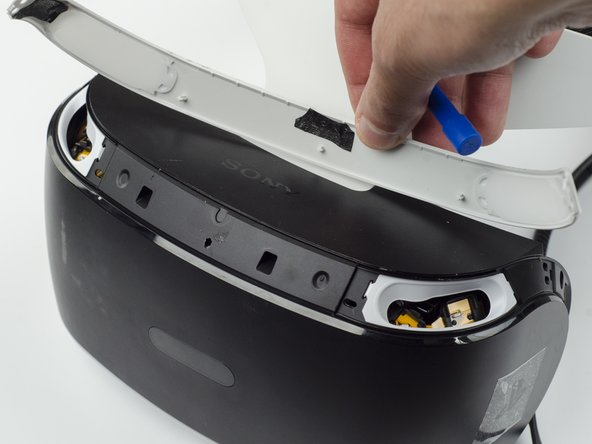 There may be a small amount of adhesive attaching the top panel to the headset, in which case you may need to use a bit more force to remove the panel.