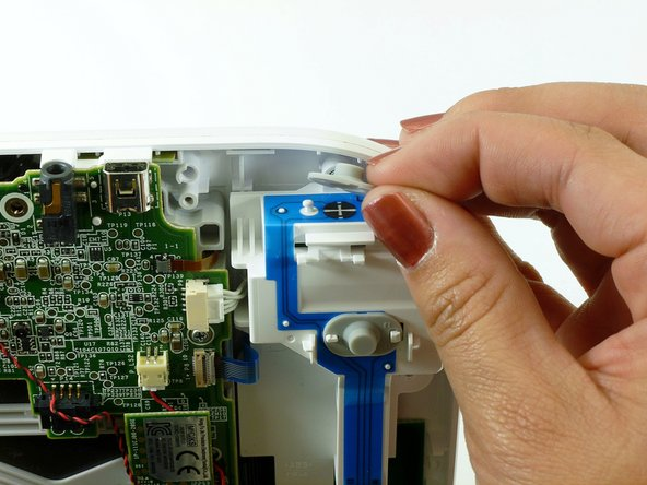 Remove the top rubber cover by pulling it off of its mounts to access one of the mounting screws.